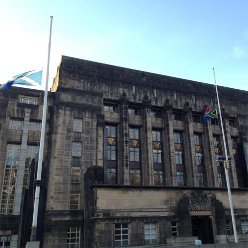 South African flag flying at half-mast