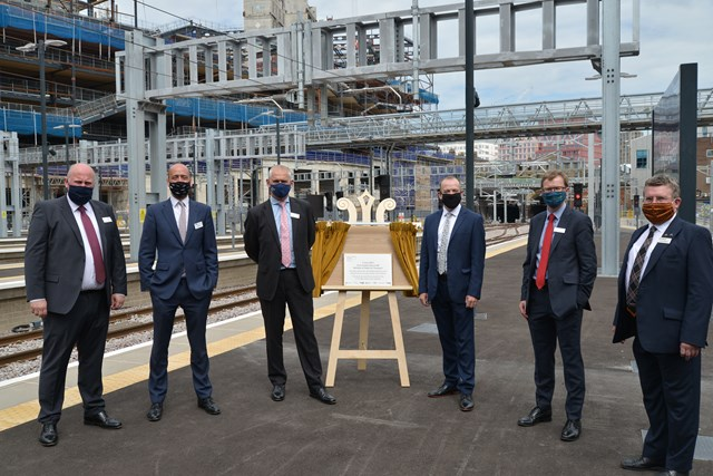The plaque unveiled at King's Cross to mark completion of the upgrade project. Pictured [from left to right]: Andy Mellors, Managing Director of non-franchised rail businesses, First Group; Tom Moran, Managing Director, Great Northern & Thameslink; Rob McIntosh, Managing Director, Eastern Region, Network Rail; Chris Heaton-Harris MP, Minister of State for Transport; David Horne, Managing Director, LNER and Richard McClean, Managing Director, Grand Central.