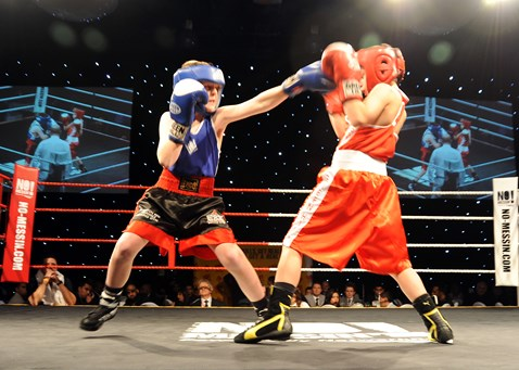 St Joseph's boxer (Jerry Connors in red) v (Everton boxer Lewis Gorman in blue) at the No Messin' Tri-nation boxing competition