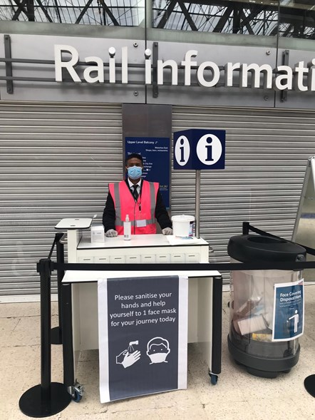 Free face coverings being handed out at London Waterloo station: Credit: Network Rail