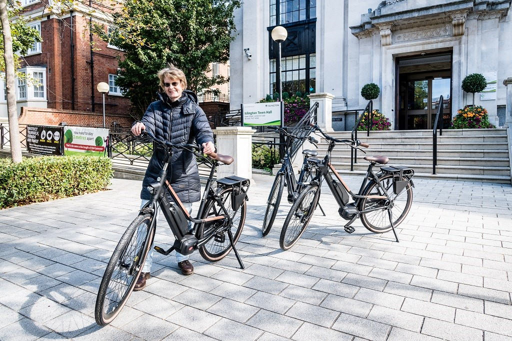 Cllr Rowena Champion with the new e-bikes, which will be used by the Street Environment Services team
