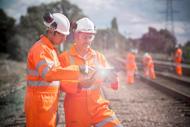 Check before you travel ahead of Easter railway upgrades between Birmingham and Wolverhampton: Track workers and engineers with iPad