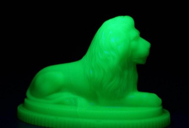 lionpaperweightinuvlight.jpg