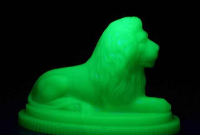 Leeds Museums and Galleries object of the week- glowing glass lion: lionpaperweightinuvlight.jpg