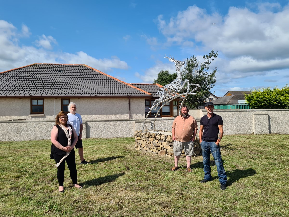 Unveiling Buckie's Darling statue: L-R: Cllr Sonya Warren; Cllr David Bremner; Paul Bijl, Stonemason; Carn Standing, artist/sculptor.