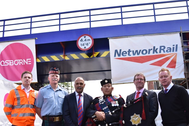 PICTURES: Network Rail unveils new bridge over Aldershot High Street: Aldershot Bridge 1: (l-r) Mark Evans, Asset Engineer at Network Rail; Lt. Col. MacGregor, Commander of Aldershot Army Garrison; Shahid Azeem, Chairman of Aldershot F.C.; a Gurkha Piper based at the Aldershot Garrison; Cllr David Clifford, Leader of Rushmoor Borough Council; Gary Waddock, Manager of Aldershot F.C.