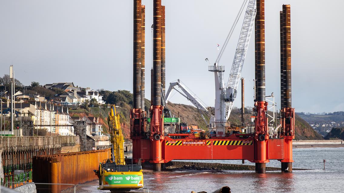 New sea wall helping protect railway through Dawlish seven years on from devastating storm: Wavewalker at Dawlish sea wall Feb 2021