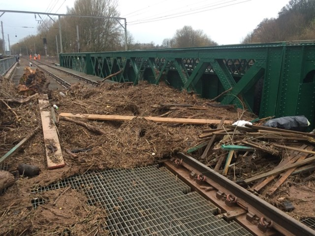 Extent of damage revealed as floodwater recedes on the West Coast main line near Carlisle: Debris strewn across the Caldew Viaduct north of Carlisle