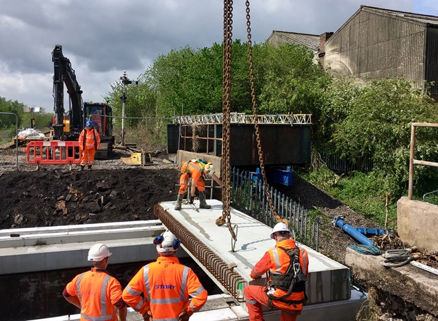 Bridge replacement in Stoke-on-Trent complete after being blown off course by Storm Hannah: Concrete sections being lowered into place by crane at Bute Street in Stoke-on-Trent