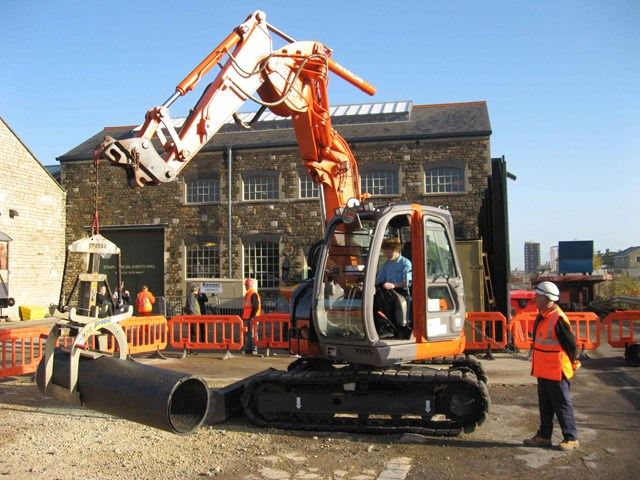 Mini-excavator at Railway Engineering Day: Pupil controlling the mini-excavator under supervision