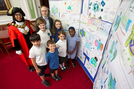 Pupils from Thornhill Primary School with climate change posters made by school students, which were put on display at Islinton Town Hall as Islington Council agreed to declare a climate emergency.  With the Mayor of Islington, Cllr Rakhia Ismail, and Cllr Richard Watts, leader of Islington Council