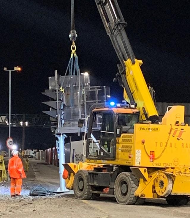 Crane lifting signalling equipment during Trafford Park upgrade