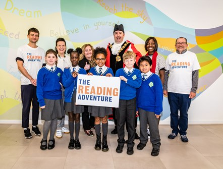 The Reading Adventure launch: Children at St Joseph's RC Primary School celebrate the launch of The Reading Adventure with (from second-left) Karen Napier, CEO of The Reading Agency, Cllr Una O'Halloran, Executive Member for Community Development, Mayor of Islington Cllr Troy Gallagher, and Cllr Valerie Bossman-Quarshie, Islington's Reading Champion.
