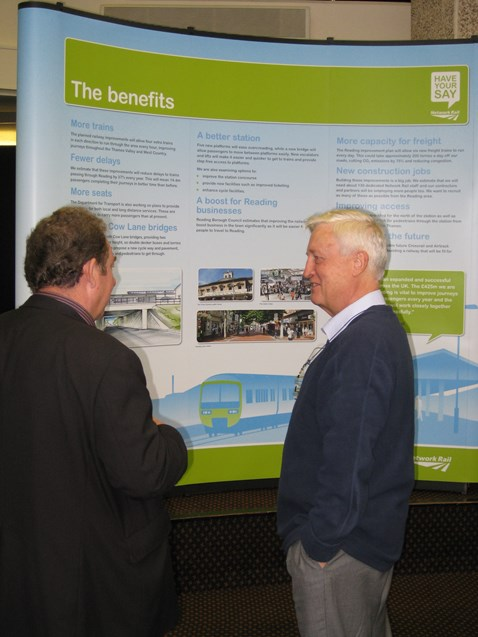 Member of the public exchanges views with Network Rail manager