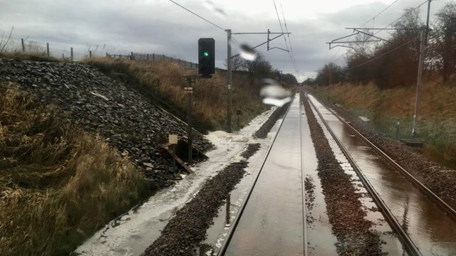 Passengers warned of West Coast main line disruption due to heavy rain today: Stock images of previous flooding from Storm Ciara February 2020