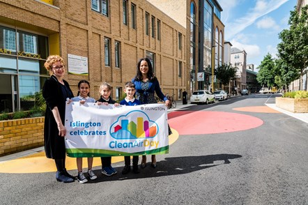 Children join Ann Dwulit, executive headteacher of Moreland Primary School (L) and Cllr Claudia Webbe (R) for the launch of Moreland Street on Clean Air Day 2019