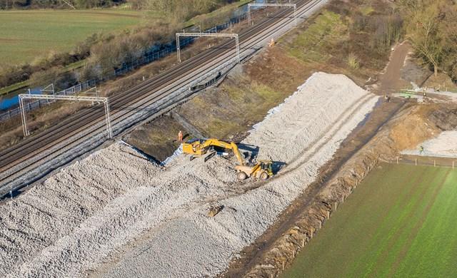 Aerial shot showing digger strengthening Hopsford Hall embankment Spring 2021