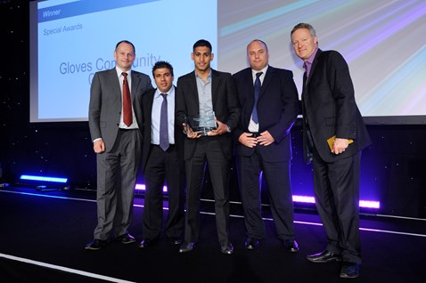 Amir Khan collects a special award for Gloves Community Centre by Iain Coucher