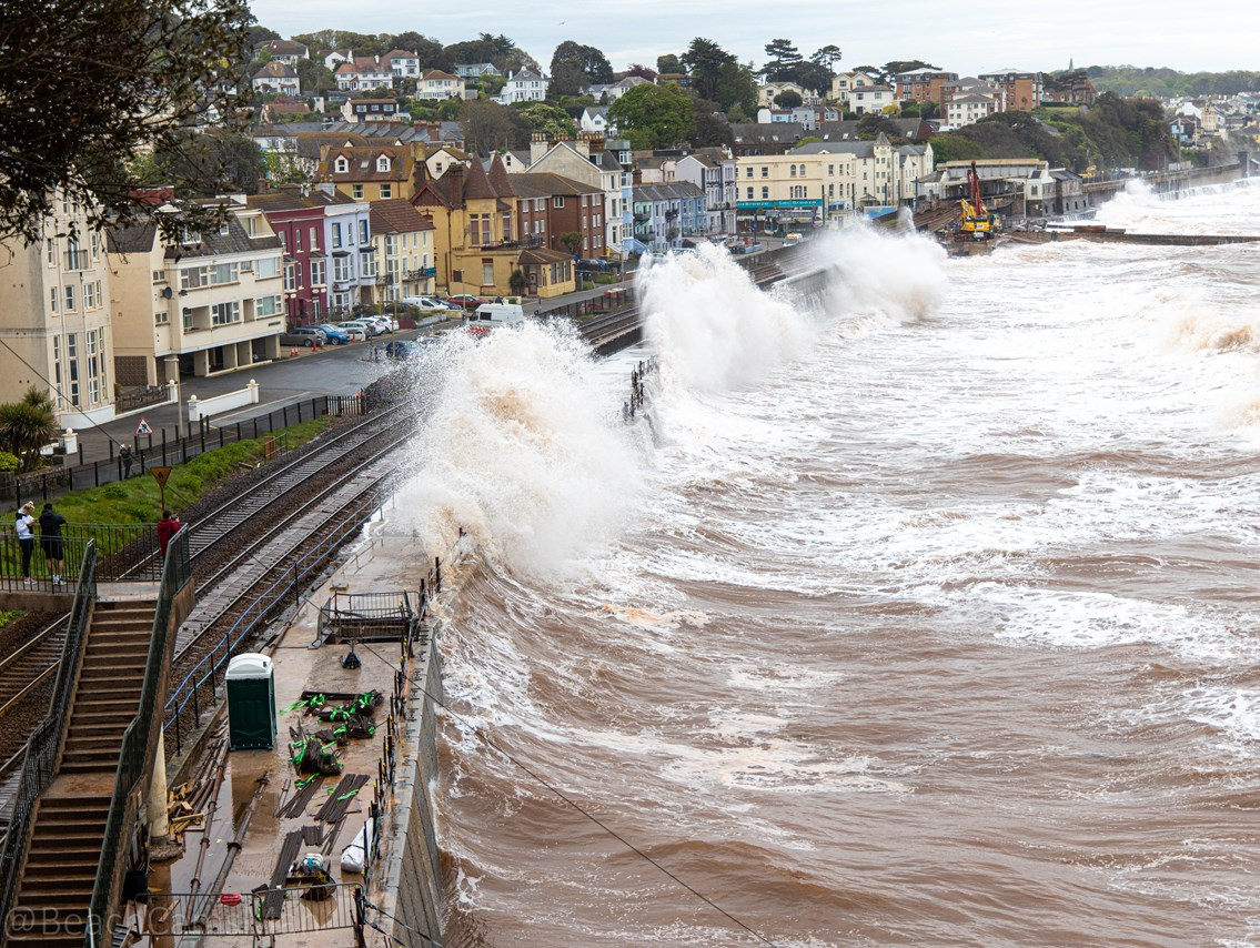 Waves crashing over the first section of new sea wall during construction