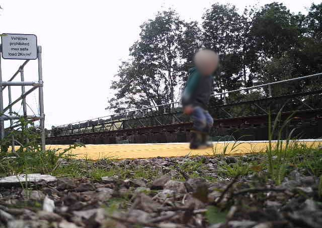 Young child trespassing on railway bridge