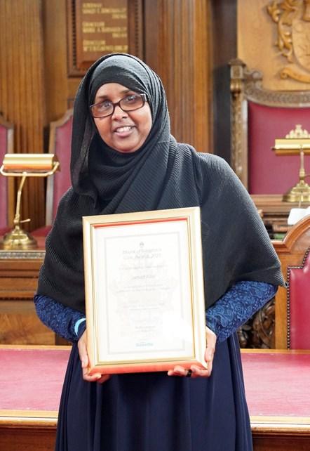 Jamad Abdi: Jamad Abdi receiving her Civic Award