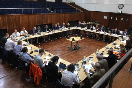 A photograph of Greater Manchester Transport Commitee sitting in session at the Friends' Meeting House in Manchester