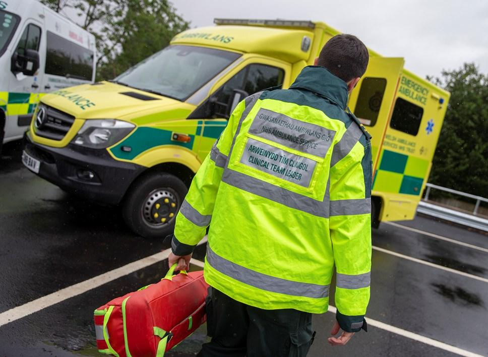 Paramedic walking to ambulance