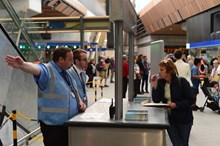 Station staff: Station staff assist a woman at the new London Bridge station