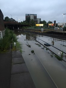 Severe weather disruption on routes through south east and south west London this morning: Clapham Junction flooded