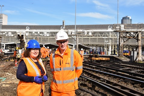 Leonie Cooper, assembly member for Merton and Wandsworth, speaks with Network Rail staff on track at Waterloo