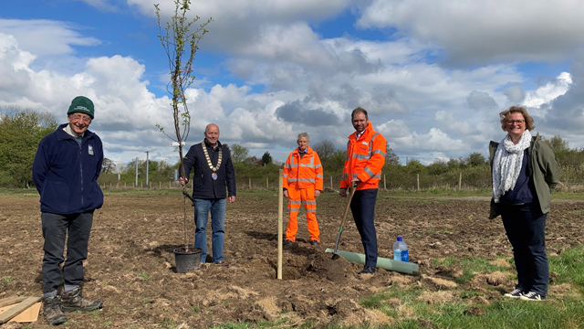 First apple tree being planted: (L-R) Richard Wilson, Chair of Sodbury Woodland and Nature (SWaN); Councillor James Ball, Mayor of Sodbury; Network Rail environment specialist, Mike Franklin; Netweork Rail interim Western route director, Chris Pearce; and Sodbury Town Clerk, Cate Davidson