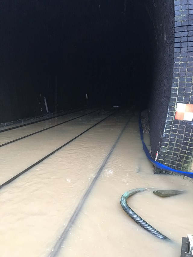 Flooding affecting railway services between London Euston and Birmingham New Street: The flooded railway tunnel at Crick on the West Coast main line