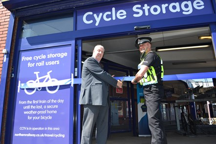 Blackpool North Cycle Storage: PC John Phillips and Blackpool North station manager Mick Elliot open the storage facility.