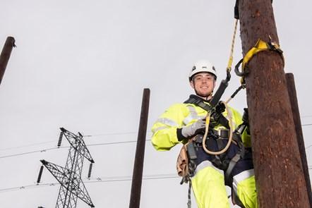 ENWL apprentice on electrical pole: ENWL apprentice up electricity pole (Photo credit: Sara Porter Photography for Electricity North West)