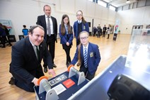 Energy Minister Paul Wheelhouse with pupils from Larbert High 2