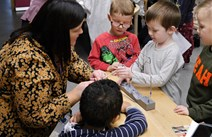 Early Learning and Chilcare Expansion Programme: A member of staff and children from Tower View Nursery in Glasgow in a science 'lesson'