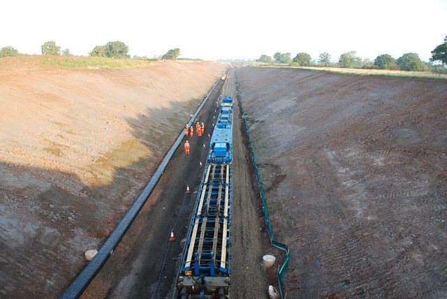Track-laying machine heading north from bridge three at Norton Bridge