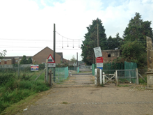 Slipe lane level crossing