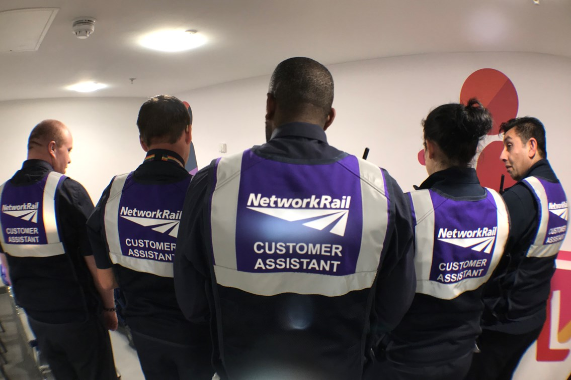 The purple uniforms are for staff who help passengers who need extra assistance