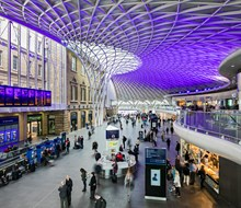 King's Cross railway station - view from balcony: king's cross railway station train station roof architecture John McAslan and Partners busy people crowds retail shops shopping
