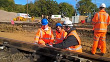 Executive leader of Fareham Borough Council, Councillor Seán Woodward, MP for Fareham Suella Fernandes and Network Rail's Director of Route Asset Management Colum Cavanagh on site at Fareham