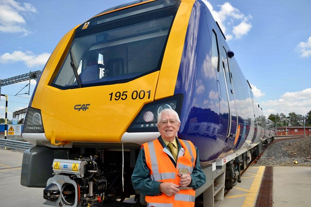 Former station master made VIP guest to celebrate 70 years since joining railway: Russell Parsons in front of new Northern CAF train