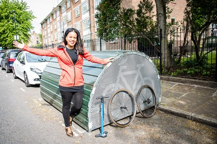 100th Bike Hangar 3: Cllr Claudia Webbe, executive member for environment and transport, celebrating the installation of the 100th on-street Bike Hangar in Islington.