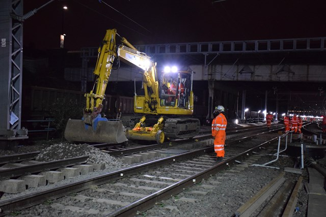 Laying ballast in Acton Wells at Christmas 2015: Christmas 2015, engineering, IP Track. high speed handback, ballast, road rail vehicle