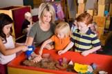 Extra nursery care will benefit 100,000 families: Education-nursery-school-teacher-pupils-play