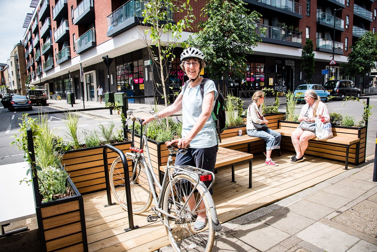 Islington's first parklet - with seating, bike parking, shrubs and a tree - in a car parking space in Central Street, EC1