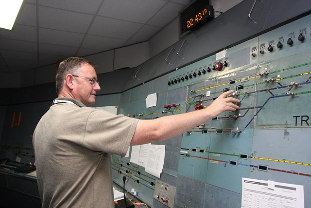 Nottingham resignalling: Trent Power Signal Box is switched out: Nottingham resignalling: Local operations manager Glyn Williams helps to signal the last train from Trent PSB - 1969-2013.