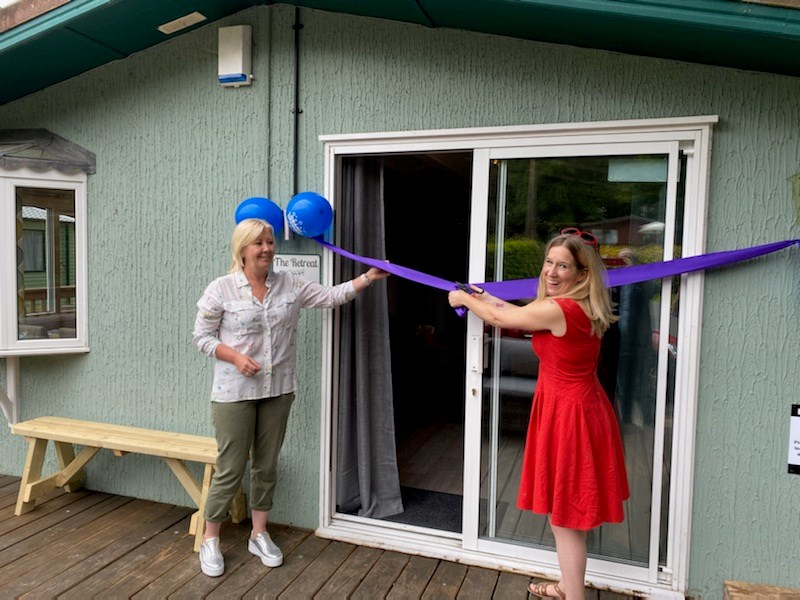 foster care lodge: (L-R) - Marie Proctor, Chair of Leeds Foster Carer Association and Cllr Fiona Venner, officially open a new holiday lodge at Rudding Park camping and caravan site.