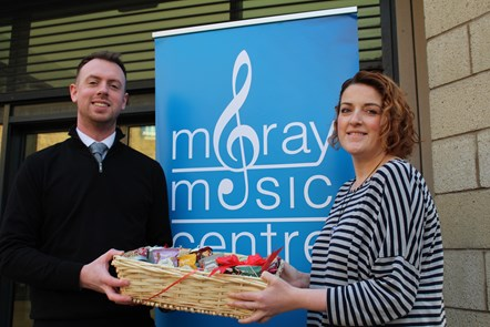 Raffle prize is music to Moray's Foodbank: Alexander Davidson and Gillian Pirie