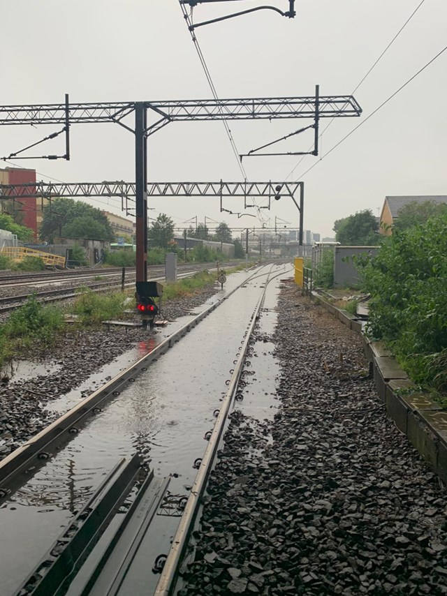 Flash flooding on West Coast main line in Camden July 12